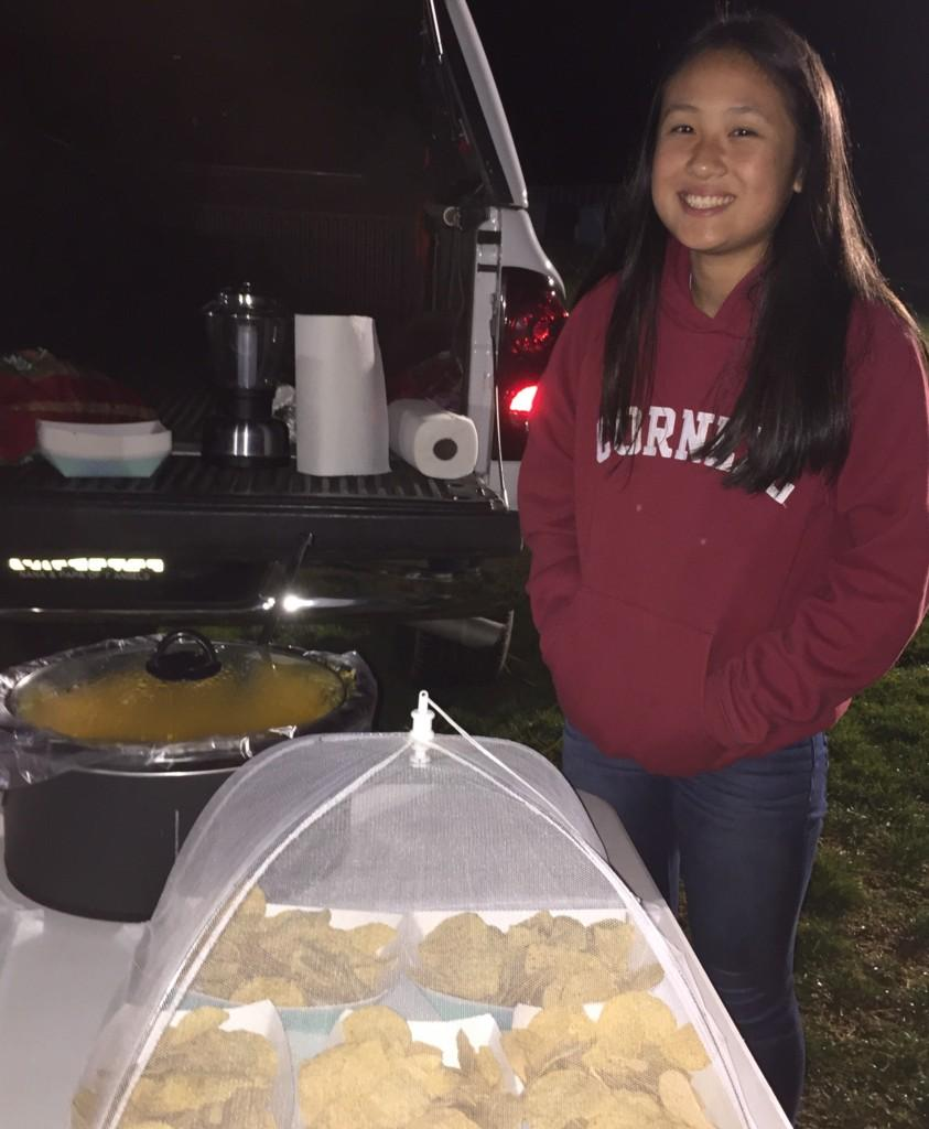 Freshman Ashley Yung sells cheesy nachos at the Bonfire Rally in order to raise money for Key Club.