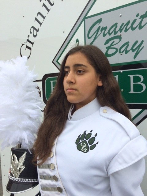 In a traditional performance outfit, Freshman Elizabeth Loya poses in front of the trailers containing the band gear the Monday after Homecoming.