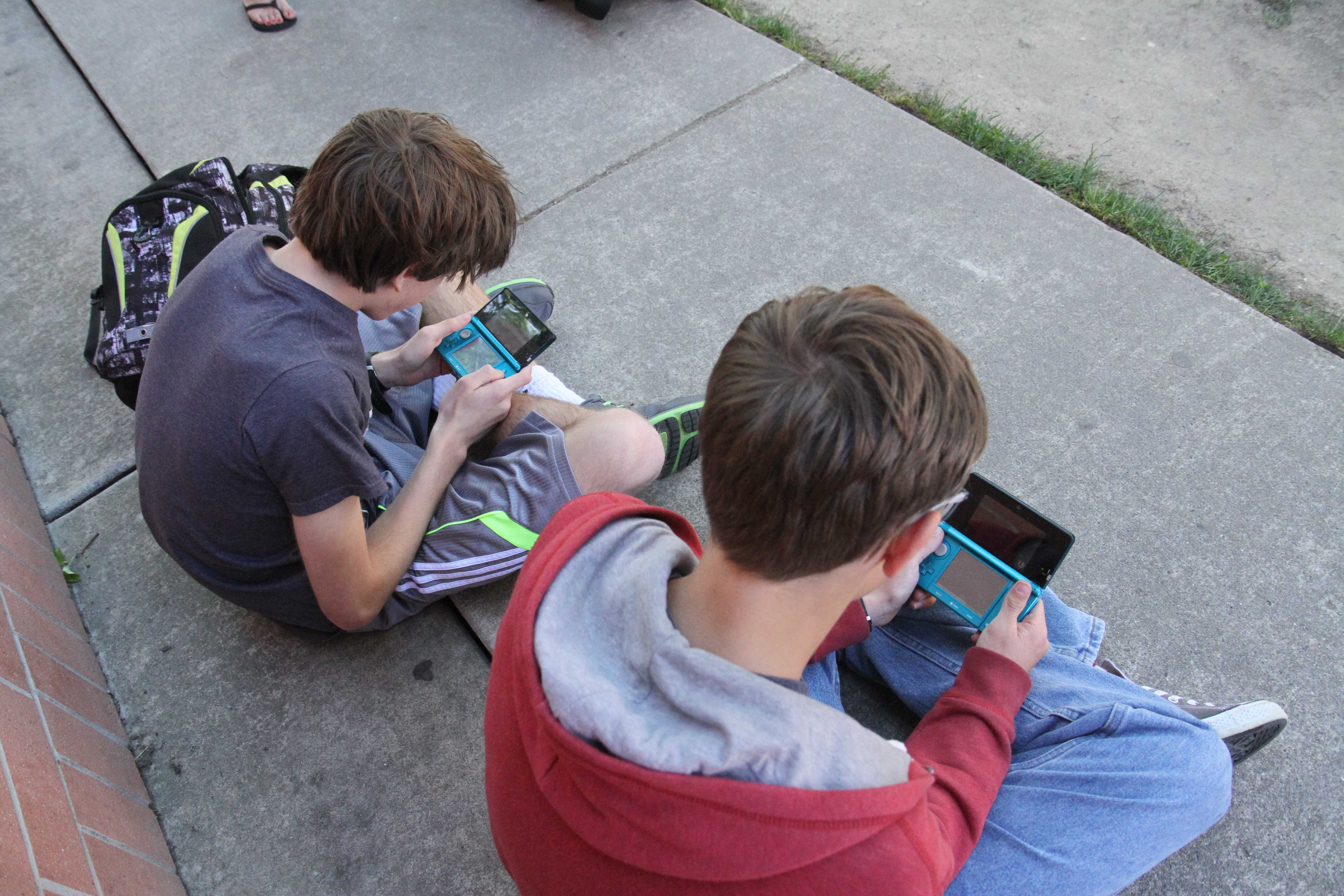 "To play as the new Pokemon character, freshman Jacob Kwiatkowski and Joe Duckhorn stay on campus after school together. They're playing Super Smash Bros for Nintendo 3DS. ""Mewtow just came out, so we're playing as him. I love Smash Bros, and have been in the Smash Club since the beginning of the year,"" Duckhorn said. Photo by Ava Lindley"