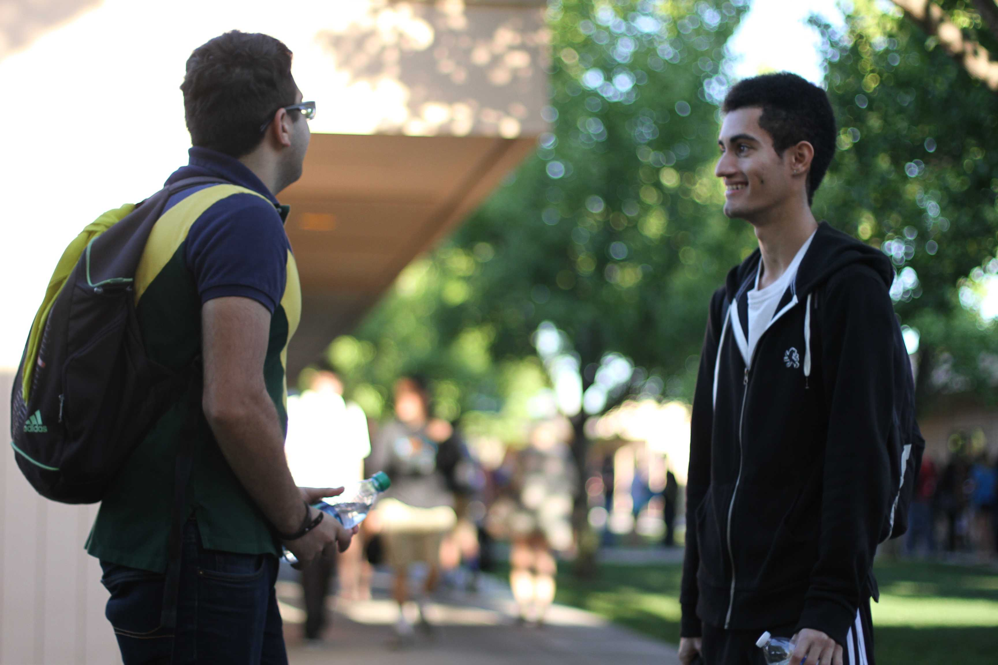 "To spend time with his friend before school starts, seniors Arya Mousavi and Robbin Bagga talk minutes before first period starts. ""I'd rather wait for class to start with my friend than wait inside because you can catch up with those friends you don't always see,"" Mousavi said.  Photo by Lindsay Withrow"