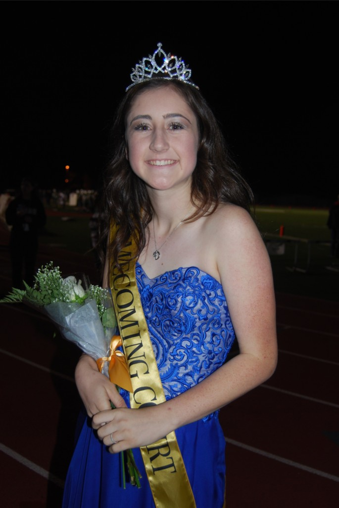 Dressed to impress, senior Danielle Griggs walks as a homecoming royalty nominee in this year's halftime show.