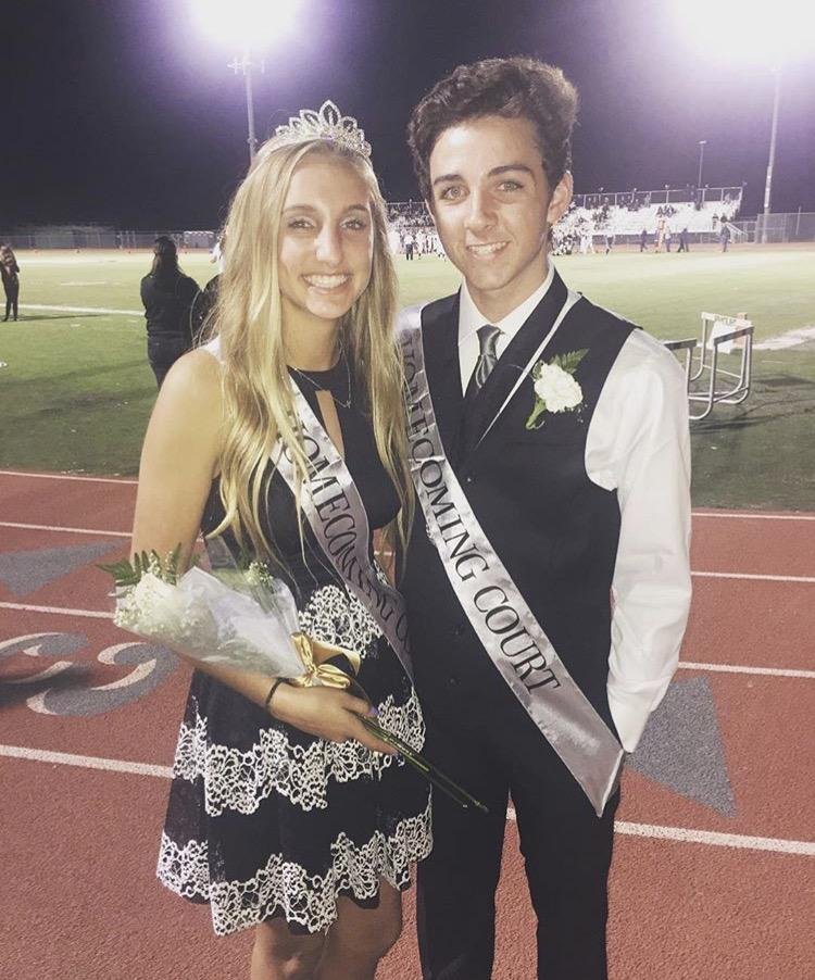 On homecoming night, freshman princess Summer Holt snaps a pic with freshman prince Cole Phillips.